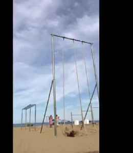 Mom Slides Down Rope and Falls During Rope Climbing at the Beach [Video]