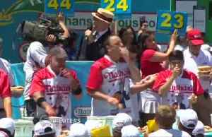 News video: Nathan's Hot Dog Eating Contest has food athletes gagging