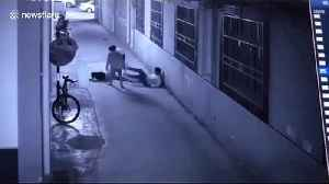 Heroic policeman saves suicidal woman by breaking her fall in China [Video]