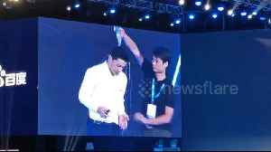 News video: 'What's your problem?!' Baidu CEO has water poured over him at event in Beijing