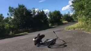 Cyclist Attempting Stunt Falls as He Tries to Lift Bike [Video]