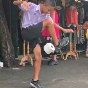 This young soccer phenom wows pedestrians by juggling toilet paper [Video]