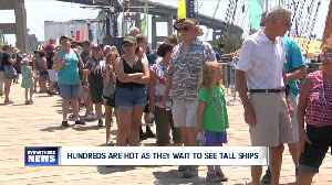Hundreds wait in extreme heat for hours to see the Tall Ships [Video]
