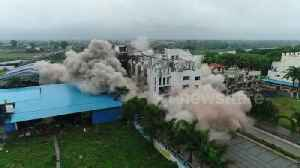 Controlled explosions demolish illegal hotel in northern India [Video]