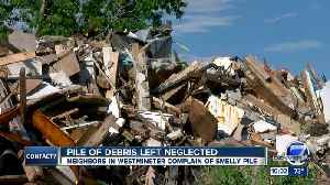 Burdened by fire-gutted eyesore for 10 months, Westbury tenants now coping with moldy debris pile [Video]