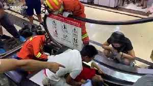 Firefighters free toddler after he got his arm stuck in escalator in Chinese mall [Video]