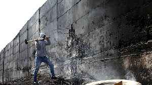 Palestinian artist: Israel's separation wall scary racist symbol [Video]