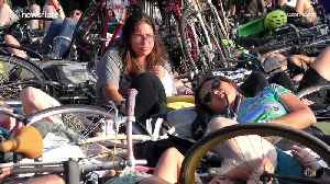 Hundreds of cyclists stage a 'die-in' protest at New York park [Video]