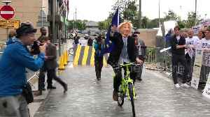 Boris Johnson impersonator rides around at Tory leadership debate in Manchester [Video]