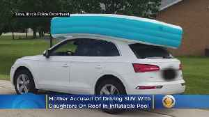 News video: Mother Accused Of Driving SUV With Her Daughters On Roof In Inflatable Pool