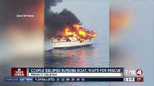 Couple escapes burning boat, awaits rescue [Video]