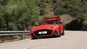 Aston Martin DBS Superleggera Volante in Cosmos Orange Driving Video [Video]