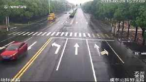 News video: Car slams into utility pole trailing from truck in China's Changshu