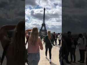 Man Surprises Girlfriend With Marriage Proposal at Eiffel Tower in Paris [Video]