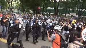 Protesters and police clash in Hong Kong after peaceful march [Video]