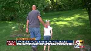 Family's Miami Township home shifts as hill slides [Video]