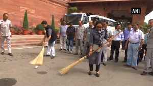 News video: BJP MPs Hema Malini, Anurag Thakur sweep road on Parliament premises