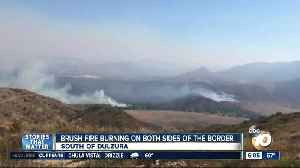 Brush fire burning on both side of US-Mexico border [Video]