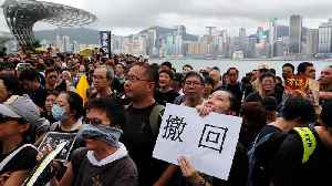 News video: Hong Kong protests: Several thousand march against mainland Chinese traders in town near border