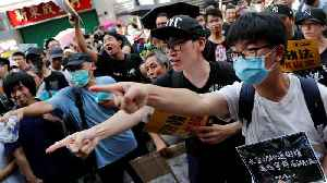 Hong Kong protesters take aim at Chinese traders [Video]