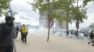 French police fire tear gas as protests follow Bastille Day parade [Video]