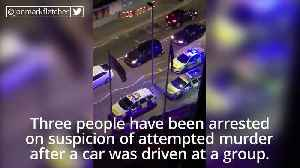 Attempted murder arrests after car drives at group [Video]