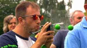 Pea shooting champion puffs a winner in world contest [Video]