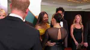 Meghan and Beyonce share a hug at Lion King premiere [Video]