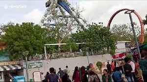 Amusement park ride crashes down in western India, killing two and injuring dozens [Video]