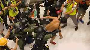 Riot police clash with protesters inside Hong Kong mall [Video]
