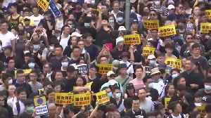 Hong Kong protesters, police clash as demonstrations target Chinese traders [Video]