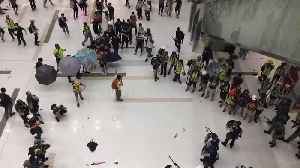 Protesters Throw Umbrellas at Police During Clashes at Hong Kong Shopping Mall [Video]