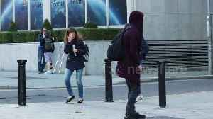 Ireland pedestrians jump and scream as they become victims of giant spider prank [Video]