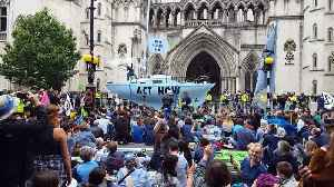 Blue boat on streets of central London as Extinction Rebellion stage latest climate protests [Video]