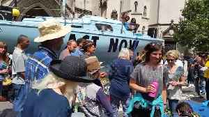 Extinction Rebellion boat blocks road outside Royal Courts of Justice in London [Video]