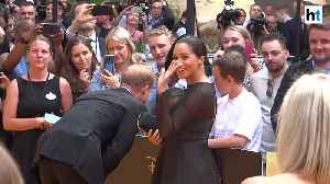 News video: Meghan Markle attends 'The Lion King' premiere with Prince Harry