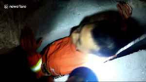 Chinese firefighters rescue girl trapped between walls after falling out of a flat [Video]