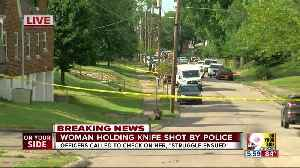 Woman holding knife shot by police, hospitalized [Video]
