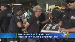 Protesters Block Midtown Intersection During Evening Rush [Video]