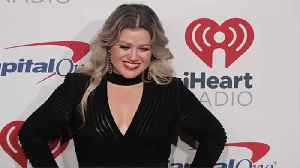 Kelly Clarkson Advises Taylor Swift to Re-Release Old Songs [Video]