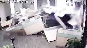 Chinese woman accidentally slams car into office injuring two people [Video]