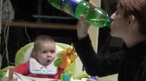 Baby's mind gets totally blown while watching mom drink [Video]