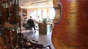 He continues the family trade started by his father: making violins [Video]