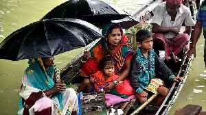 India's monsoon floods kill dozens, displace thousands