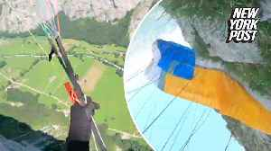 Paraglider crashes face-first into the side of a mountain [Video]