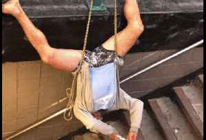 News video: Man Hangs Upside Down While Playing Flute in NYC Subway Station
