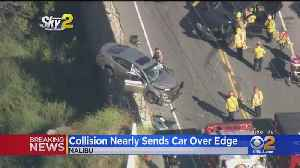 2-Vehicle Crash Leaves Car Teetering On Edge Of The Road [Video]