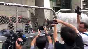 Hong Kong police erect barricades outside HQ as a major protest is held [Video]