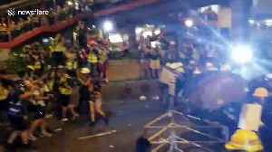 Hong Kong police fire tear gas as protesters approach police lines [Video]