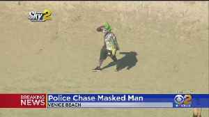 Who Was That Masked Man? Joker, Uh, Suspect Leads Police On Wild Chase [Video]